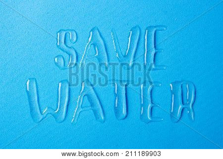 Save the water and save life on the planet. Letters from spilled water drops