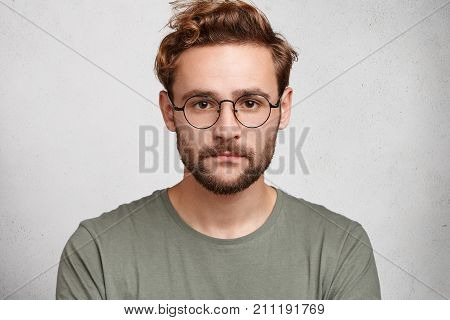 Headshot Of Serious Bearded Man With Mustache And Beard, Wears Round Spectacles, Has Stylish Hairdo,