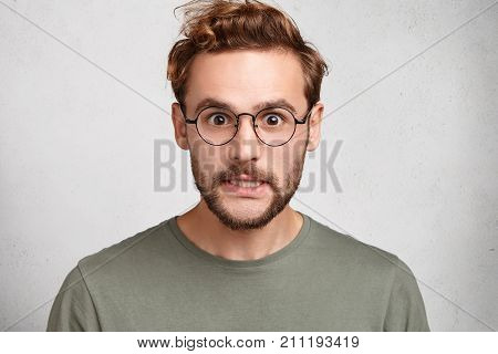 Isolated Shot Of Angry Man Clenches Teeth, Can`t Control Emotions, Being Annoyed With People Who Sur