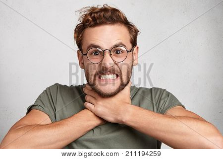 Irritataed Fed Up Man Clenches Teeth, Makes Suicide Gesture, Tries To Choke Himself, Being Annoyed A