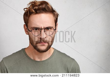 Gloomy Bearded Man With Serious Grumpy Expression, Looks Strict, Being Angry With Someone, Has Irrit
