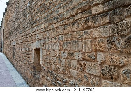 Background sand stone textured wall close-up museum
