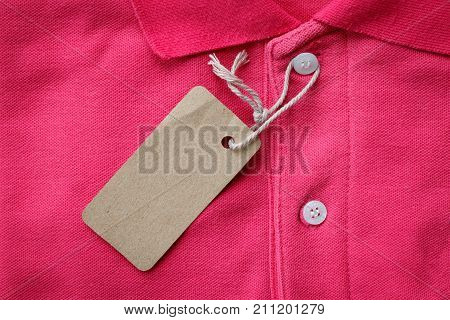 Close up top view of man polo shirt put on rustic wooden table top with blank space use for texts display