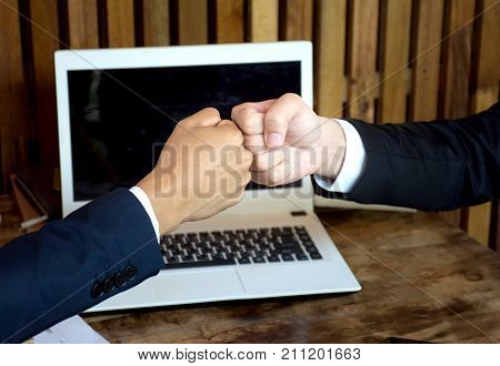 Close up of Fist Bump Friends Deal Partner Touch Pair Hands/Business Partners Trust in Team, Teamwork Office Concept