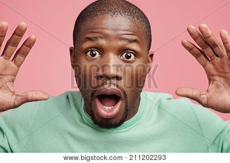 Scared Stupefied African American Young Handsome Man Looks With Bugged Eyes And Opened Mouth, Keeps