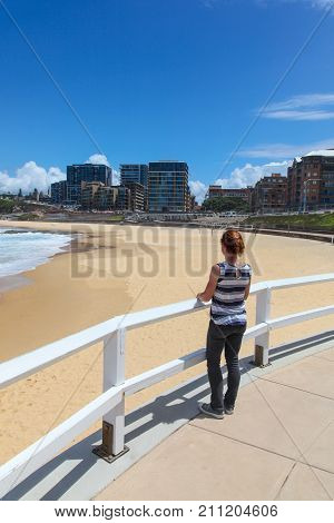 A woman enjoys the view at Newcastle Beach. This beach a few minutes from the CBD is one of the highlights of the Newcastle New South Wales second largest city a few hours north of Sydney.