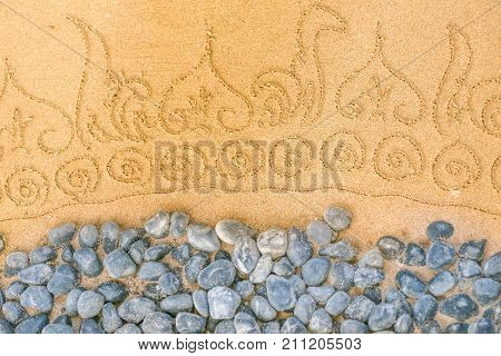 Pattern On Clean Sand With Stones. The Concept Of Peace And Contemplation