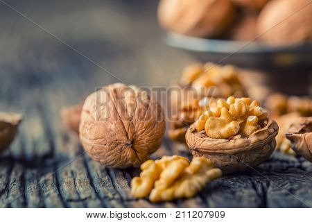 Walnut. Walnut Kernels And Whole Walnuts On Rustic Old Oak Table