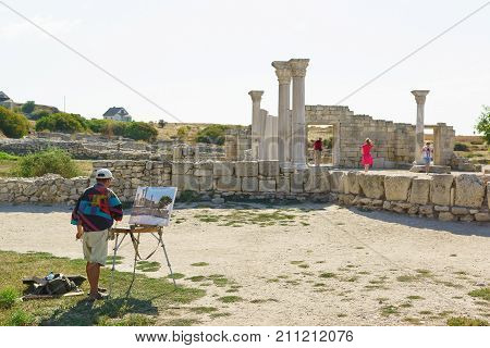 The Artist Draws The Remains Of Ancient Greek Basilica Of The Vi-x Centuries In Chersonesus Tavriche