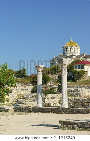 Marble Columns Of Ancient Greek Basilica Of The Vi-x Centuries On The Background Of Vladimir Cathedr