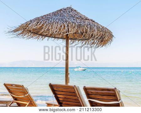 Sunshade umbrella on the beach with clean blue sky