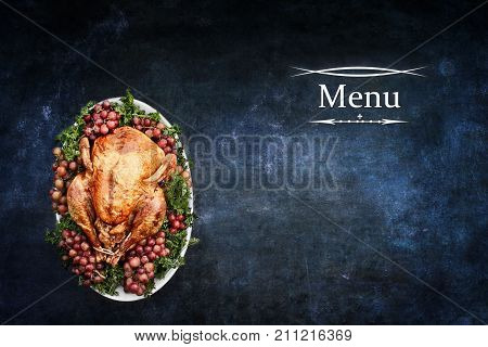 Menu for Thanksgiving Day or Christmas turkey dinner over a blank chalkboard or blackboard with room for copy space.