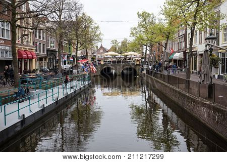 ALKMAAR NETHERLANDS - APRIL 21 2017: Historic 17th century gabled houses at Mient canal central Alkmaar Netherlands