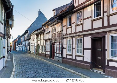 Cobblestoned Street With Half-timbered Houses In The Center Of Goslar