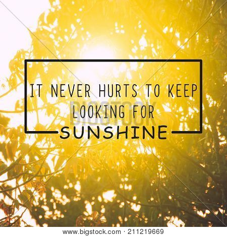 Life inspirational quotes - It never hurts to keep looking for sunshine. Blurry retro background.