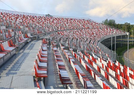 Empty grandstand sports facilities with colored plastic seats