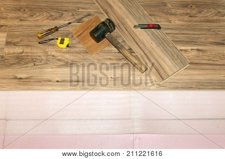 Installing wooden laminate flooring with insulation in the house, setting new floor after flood