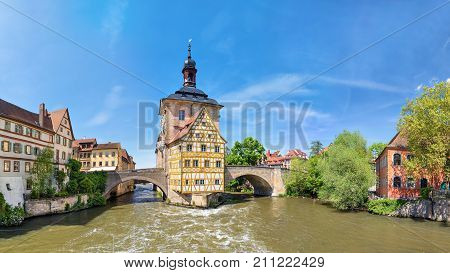Bamberg. Panoramic view of Old Town Hall of Bamberg (Altes Rathaus) with two bridges over the Regnitz river Bavaria Germany