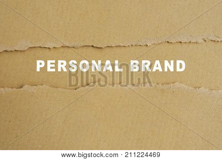 Personal brand words on torn brown paper