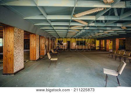 Abandoned children's canteen. Derelict dining room in pioneer camp.
