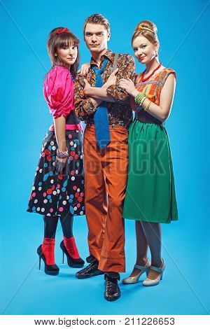 Young people wearing colorful old-fashion clothes in pinup style. Also they can represent members of a youth counterculture Stilyagi existed from the late 1940s until the early 1960s in the Soviet Union