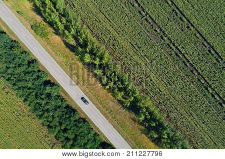 Aerial View Of A Highway Passing Through Green Fields