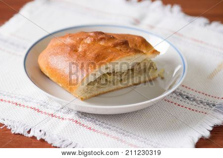 Fresh Hot Russian Pies With Cabbage And Meat. Sliced Pie On A Plate - A Traditional Russian Dish