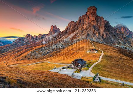 Fantastic sunset landscape alpine pass and high mountains Passo Giau with famous Ra Gusela Nuvolau peaks in background Dolomites Italy Europe
