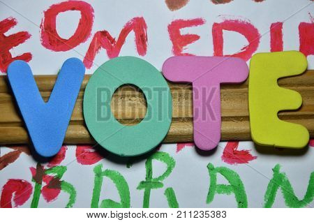 word vote on a  abstract colored background