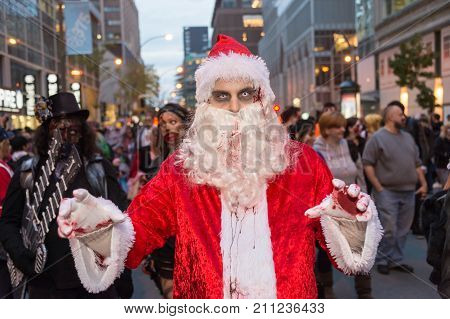 Montreal Canada - October 28 2017: Undead Santa Claus taking part in the Zombie Walk in Montreal Downtown