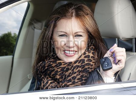 Young Woman With Keys Of New , Hire Or Rental Car