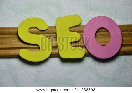 the word seo on a  abstract colorful background