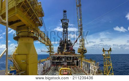 Oil rig tender type is working on oil and gas remote platform to completion gas reservoir well.