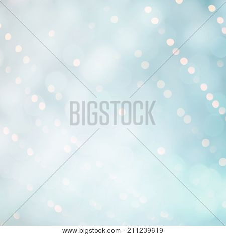 Delicate Beautiful Abstract Blue White Background with Bokeh circles. Soft Texture with particles. Can be used as a backdrop for design greetings cards invitations or promotion flyers.