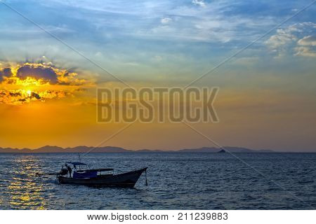 Sunrise Longtail Boat With Rock Islands On Horizon. Thailand