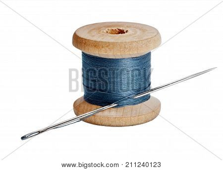 Needle And Wooden Spool Thread