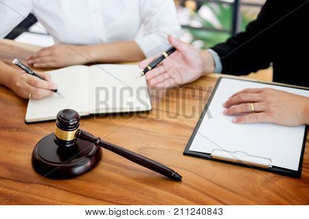 Business People And Lawyers Discussing Contract Papers Sitting At The Table. Concepts Of Law, Advice