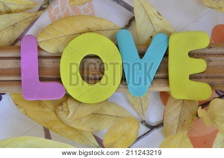 the word lve on a  abstract colorful background