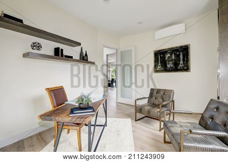 White Home Office Interior Furnished With Leather Chairs