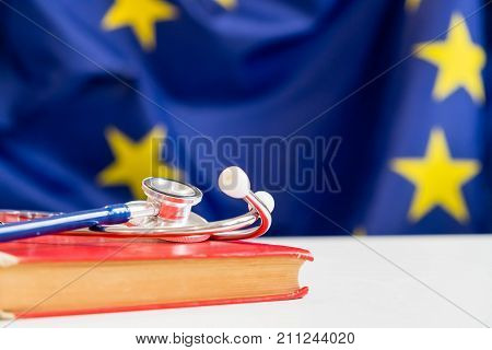 stethoscope with European Union flag. Concept of the health of Europe. Stethoscope over European Flag stethoscope with a book education concept