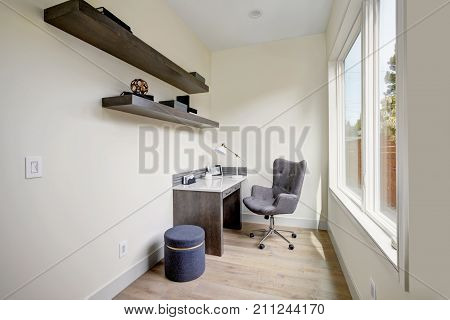 Light Small Home Office Interior With Corner Desk And A Chair