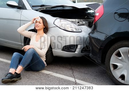 Injured girl after car accident in the street