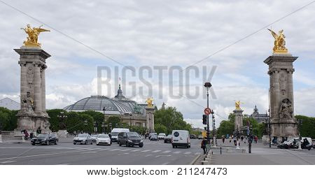 Paris; France-May 02; 2017: View of the Pont Alexandre lll. On the bridge are pedestrians and cars