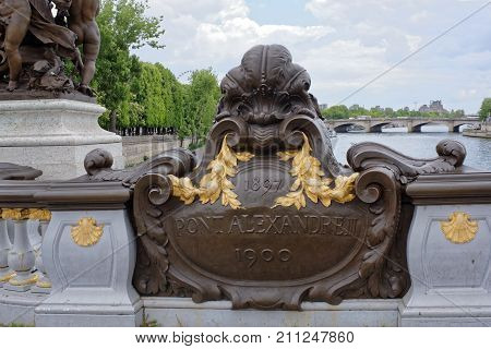 Paris; France-May 02; 2017: View of the Pont Alexandre lll. Plaque it has the date 1897 which is when construction started and below - 1900 which is when this was completed