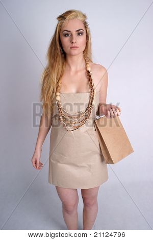 Woman wearing eco dress holding eco bag