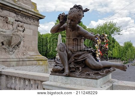 Paris; France-May 02; 2017: View of the Pont Alexandre lll. Child with Fish