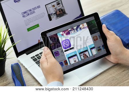 Alushta Russia - June 7 2017: Man holding iPad Pro with client messaging and voice service Viber on the screen. iPad and Macbook was created and developed by the Apple inc.