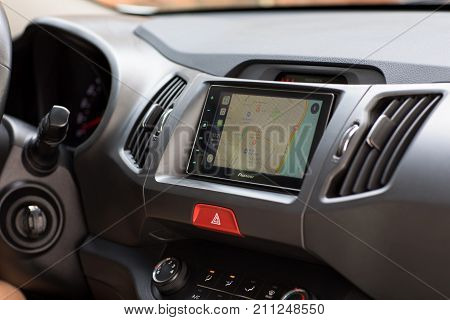 Alushta Russia - April 18 2017: Car Play on the multimedia system with Apple Maps on the screen. Apple Maps and Car Play was created and developed by the Apple inc.