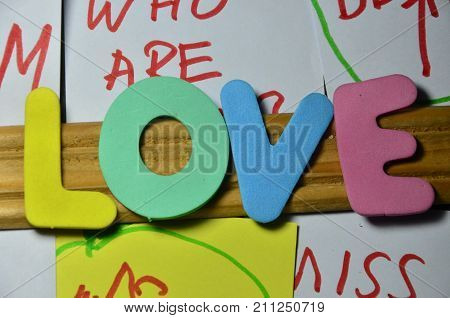 the word love on a  abstract colorful background