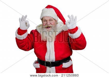 Santa showing ok sign, white background. Joyful Santa Claus making okey sign with both hands on white background.